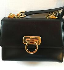 Salvatore Ferragamo Small Black Leather Shoulder Bag with Gold Tone Hardware.