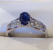 HIMALAYAN KYANITE 1 CT OVAL FACETED, WHITE TOPAZ RING IN PLATINUM OVER STERLING