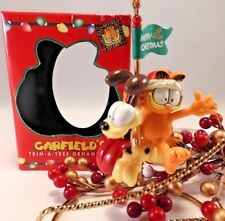 Paws 20 years of Garfield Ornament 1996 Garfield with Odie Carousel  Has Box