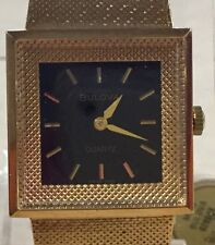 Beautiful Running New with Tags Women's Bulova Gold with Black Face Wrist Watch
