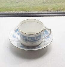 Coalport Bone China Revelry Cup and Saucer  Blue Panels White Cupids.