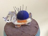PIN CUSHION IN THE FORM OF A GLASS BABY ELEPHANT