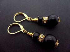 A PAIR OF DANGLY BLACK ONYX BEAD GOLD PLATED LEVERBACK HOOK EARRINGS.