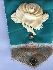 Vintage carved bone, celluloid flower brooch.