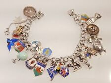 Vintage Sterling silver charm bracelet with 25 unique charms