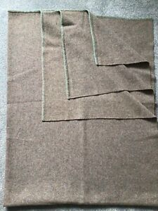 VINTAGE 1940'S-50'S BROWN WOOL BLANKET EDGED IN GREEN STITCHING TOP AND BOTTOM.