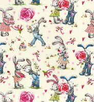 CREAM FABRIC WITH A DESIGN OF COURTING BUNNIES  -  100%COTTON F.Q.'S