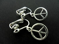 A PAIR OF CUTE LITTLE  TIBETAN SILVER  PEACE SIGN CLIP ON EARRINGS. NEW.