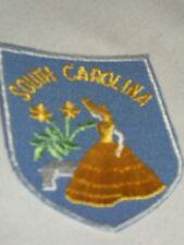 South Carolina State Souvenir Fabric Patch Blue Woman Yellow Flowers Plant Bench