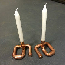 a Pair of Copper Pipe Candle Holders Candelabras