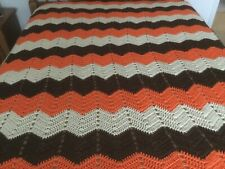 Afghan.  5ft. x6ft.  Orange, dark brown and white.