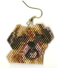 "A pair of hand beaded Puggle the Pug Dog head dangle earrings. 1 3/8"" long"