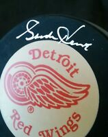 Original Gordie Howe signed hockey puck