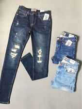 ASOS Girl Jean Denim size 8 to 12 (26 to 30 US) with stylish tear