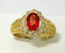 Ladies 18k yellow gold oval natural reddish/orang Sapphire diamond ring