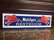 Mobil oil Mobiloil pegasus Restroom gas Gasoline advertising sign