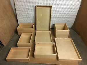 Assortment of real Maple Wood pantry pullout Drawers with Undermount Cutouts