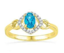 Swiss Blue Topaz Diamond Ring 10K Yellow Gold 6x4mm Oval Gemstone  .10ct Accents