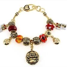 Gold Toned Charm Bracelet With Red and Buddha Charms