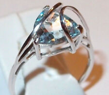 Sky Blue Topaz solitaire, looping bands, rhodium plated Sterling Silver, Size S.