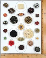 Card of 25 EXTRUDED Celluloid & Vintage Plastic BUTTONS String/Knot Designs