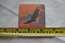 "Soaring Bald Eagle Ceramic Magnet in Pinkish Orange/Bluish Purple Sky 2"" Square"