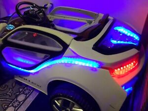 Electrical toy car (includes remote, lights and sound)