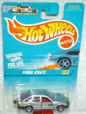 Hot Wheels 1997 #615 Ford XR4Ti silver,red int,5 spoke wheels, excellent card