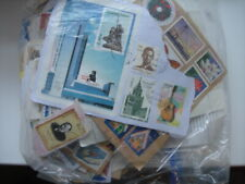 Over 300gms of mainly charity collected world stamps kiloware. No GB