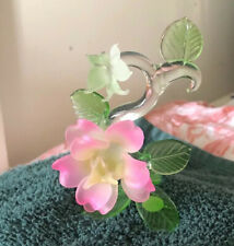 Beautiful Glass Pink Rose sitting on a Base of Leaves with Butterfly