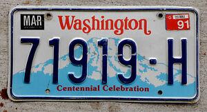 1990 Washington Blue Mountains Centennial License Plate with a 1991 Sticker
