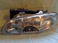 1996 1997 1998 96 97 98 Pontiac Grand Am headlamp NOS NEW