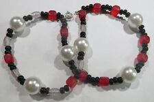 Bracelet artisanal 2 rangs avec 6 perles blanches, petites perles noires, élémen