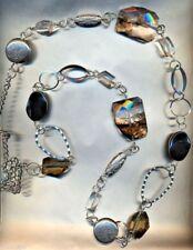 Lunga collana argentata con onice nero e cristallo