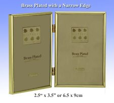 "Brass Plated Hinged Double Photo Frame with a Velvet Back.(2½""x 3½"").(1-400-02)."