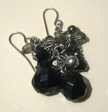 Lovely silver tone metal dangle earring with various black and silver beads