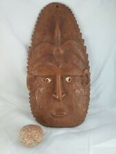 Exotic mask origin unknow: carved from single piece of wood, shell/stone eyes!
