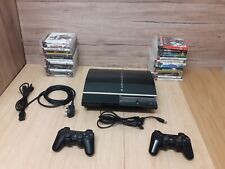 Ps3 console 74gb with 2 controllers, 26 games and cables