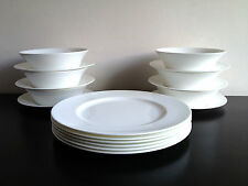 A 18 Piece Simply White Fine Bone China Combination Setting.