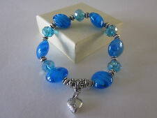 crystal charm stretch bracelet in blue color with silver beads.