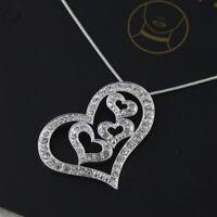 Silver tone interlocked hearts / heart pendant necklace