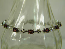 BRACELET:  PURPLE/RASPBERRY RHODOLITE OVAL (6X4MM) 7-1/2 IN  925 STERLING SILVER