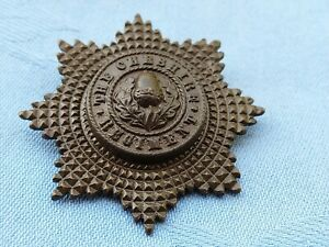 The Cheshire Regiment Officers Service Dress cap badge.   1922 pattern.