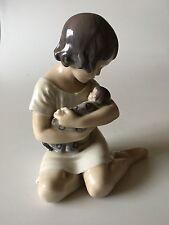 Royal Copenhagen Figurine Girl with doll #1938