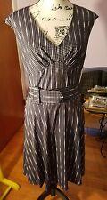 Womens dress, Black w/ white polka dots. Has belt. V neck Size L. Classic. New.