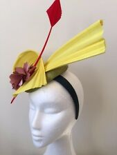 NEW green fascinator with yellow ginsin, red arrow feather and pink flower!