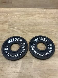 2 - Weider International Olympic Plates: 2 3/4 Lbs., 1 1/4 KGs, 2.75 pounds