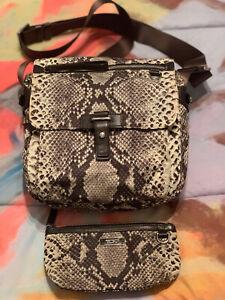 Tumi womens crossbody Animal Print. Canvas With small matching bag. Snake Print