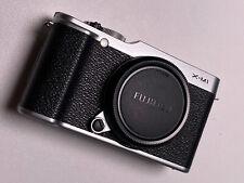 Fujifilm X-M1 16.3MP digital camera chrome body and Charger