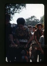 1960s  35mm  photo slide People meet and greet a monkey